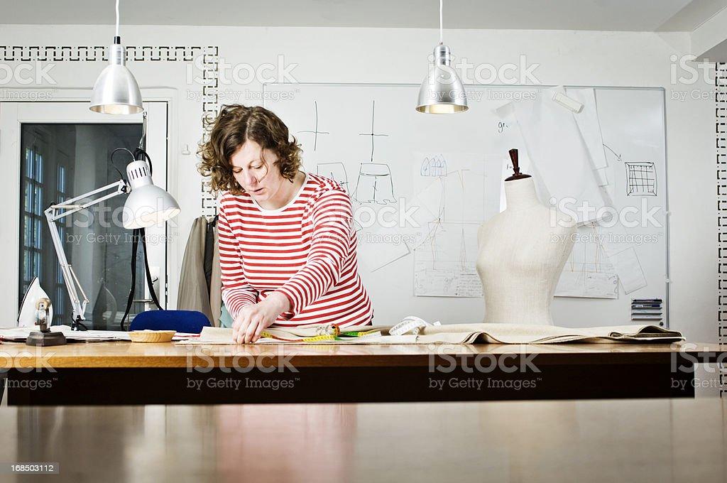 Dressmaker At Work In Her Deign Studio royalty-free stock photo