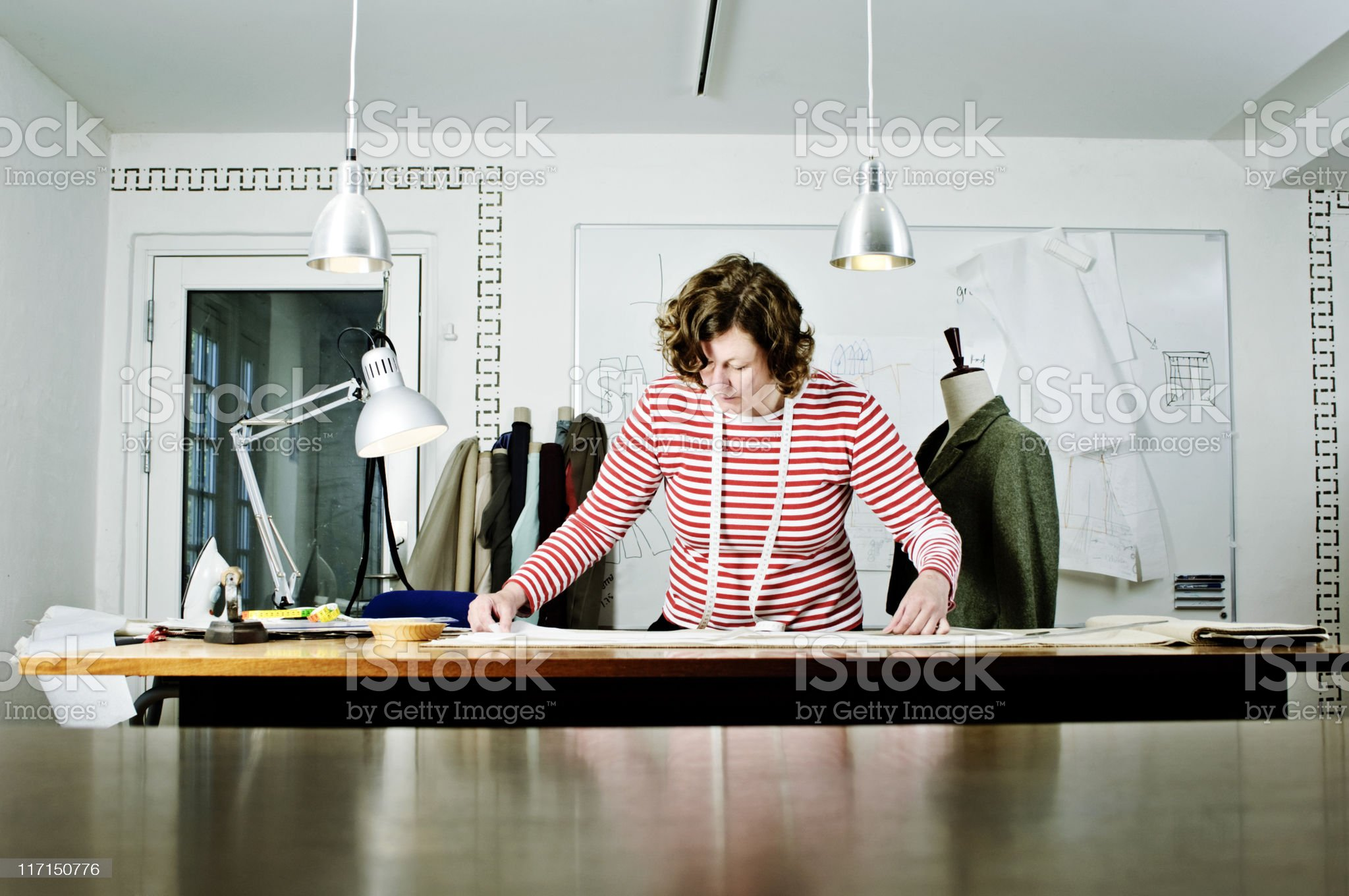 Dressmaker At Work In Her Design Studio royalty-free stock photo