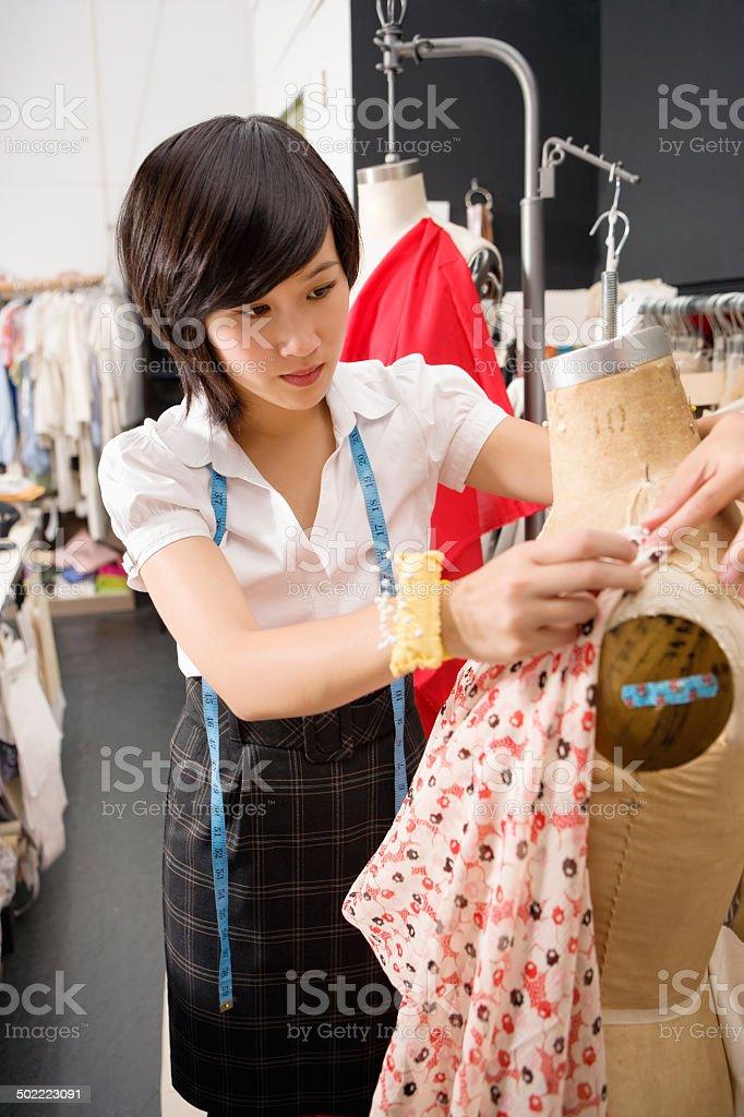 Dressmaker at work stock photo
