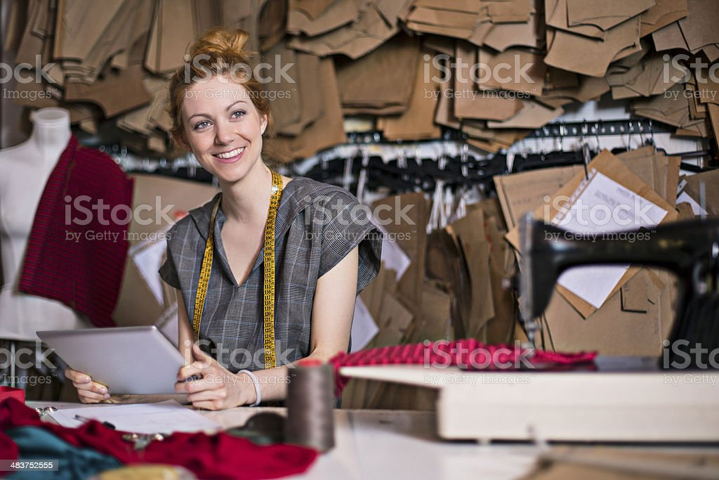 Dressmaker in her workshop royalty-free stock photo
