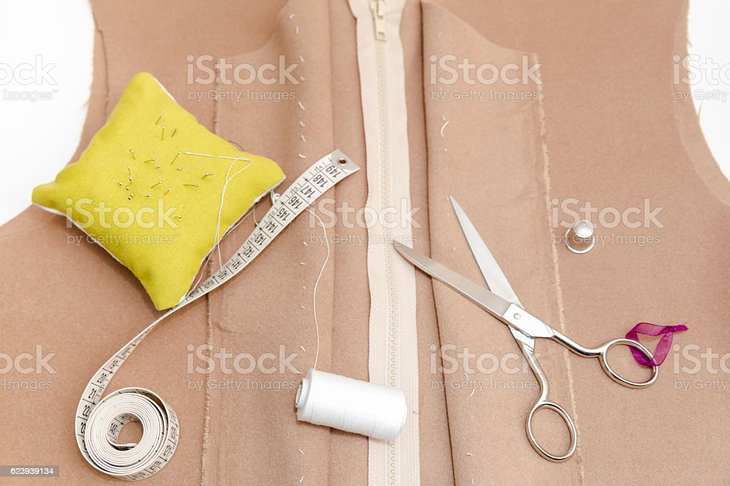 Dressmaker prepares wrap detail with sketch lines. stock photo