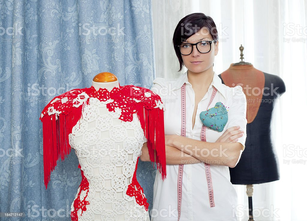 Dressmaker with mannequin working at home royalty-free stock photo