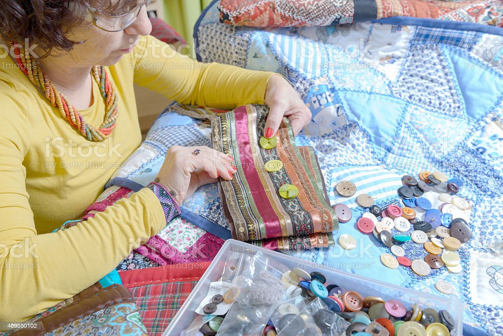 dressmaker working on her patchwork stock photo