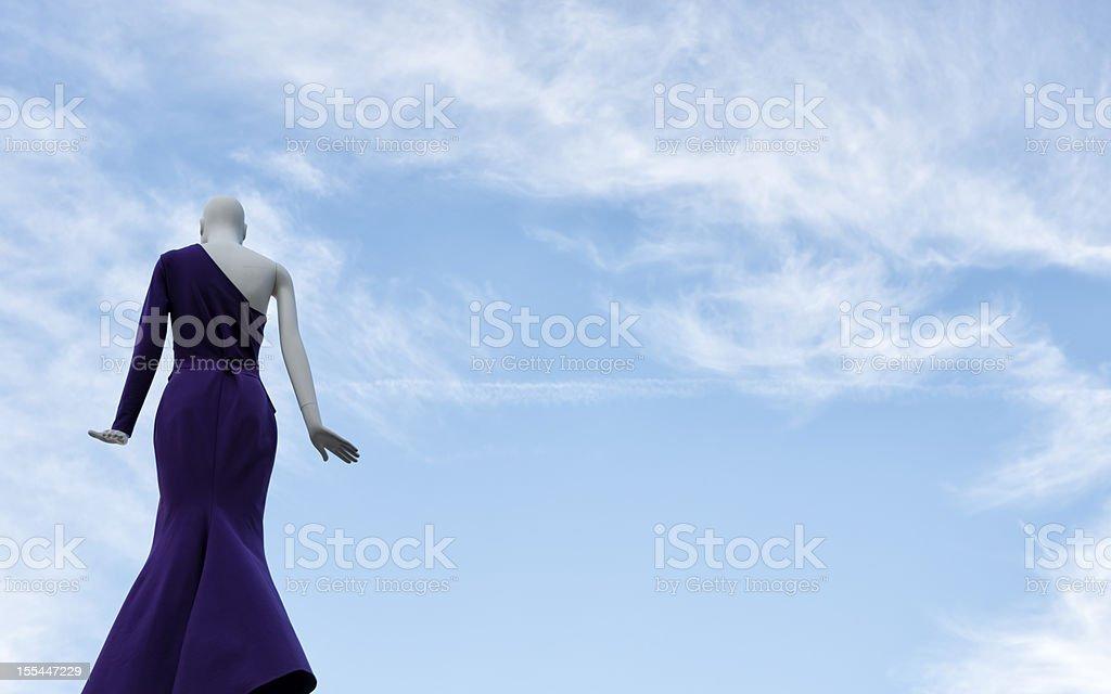 Dressmaker's Dummy against blue sky. royalty-free stock photo