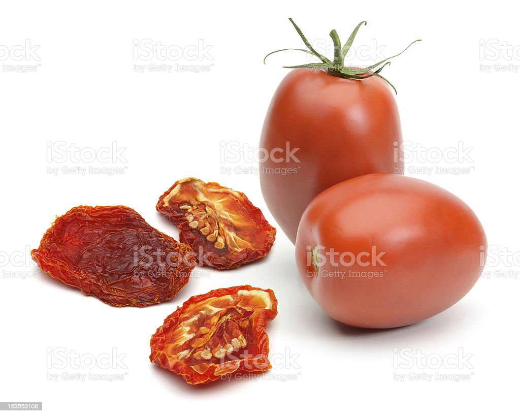 Dried and fresh plum tomatoes on a white background stock photo