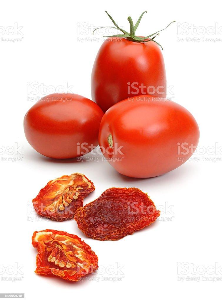 Dried and fresh plum tomatoes stock photo