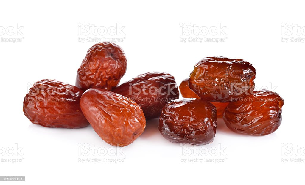 dried and sweetened Jujube fruite on white background stock photo
