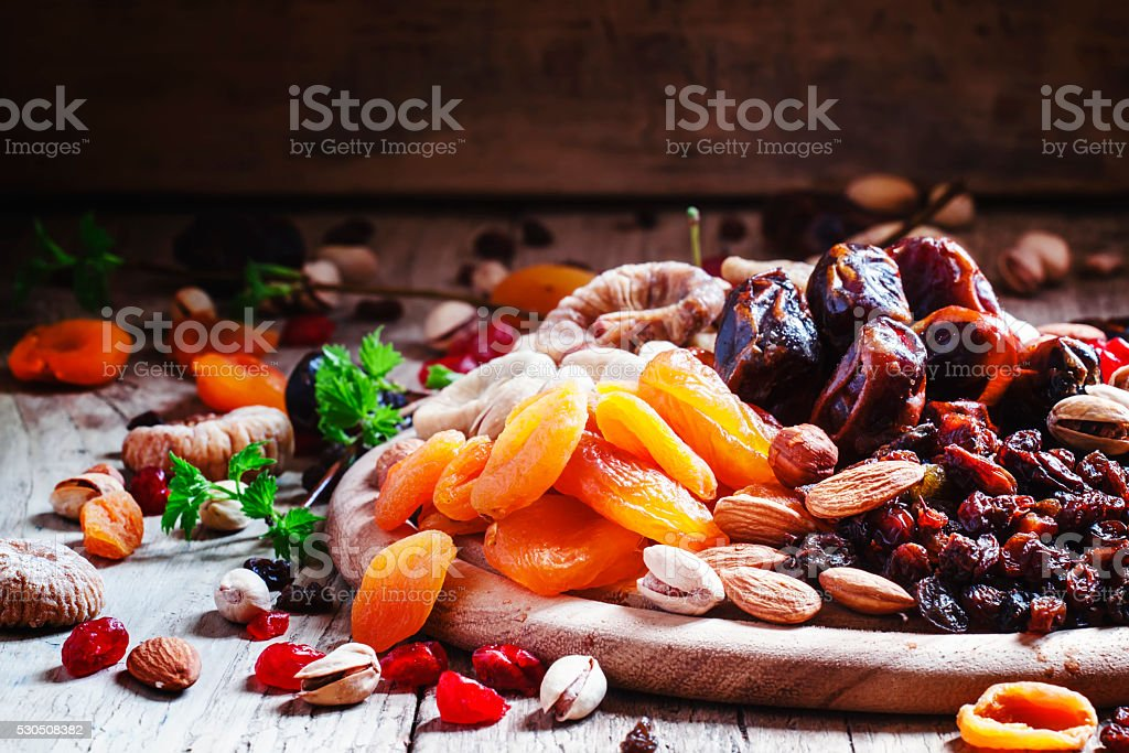 Dried apricots, dates, raisins and various nuts stock photo