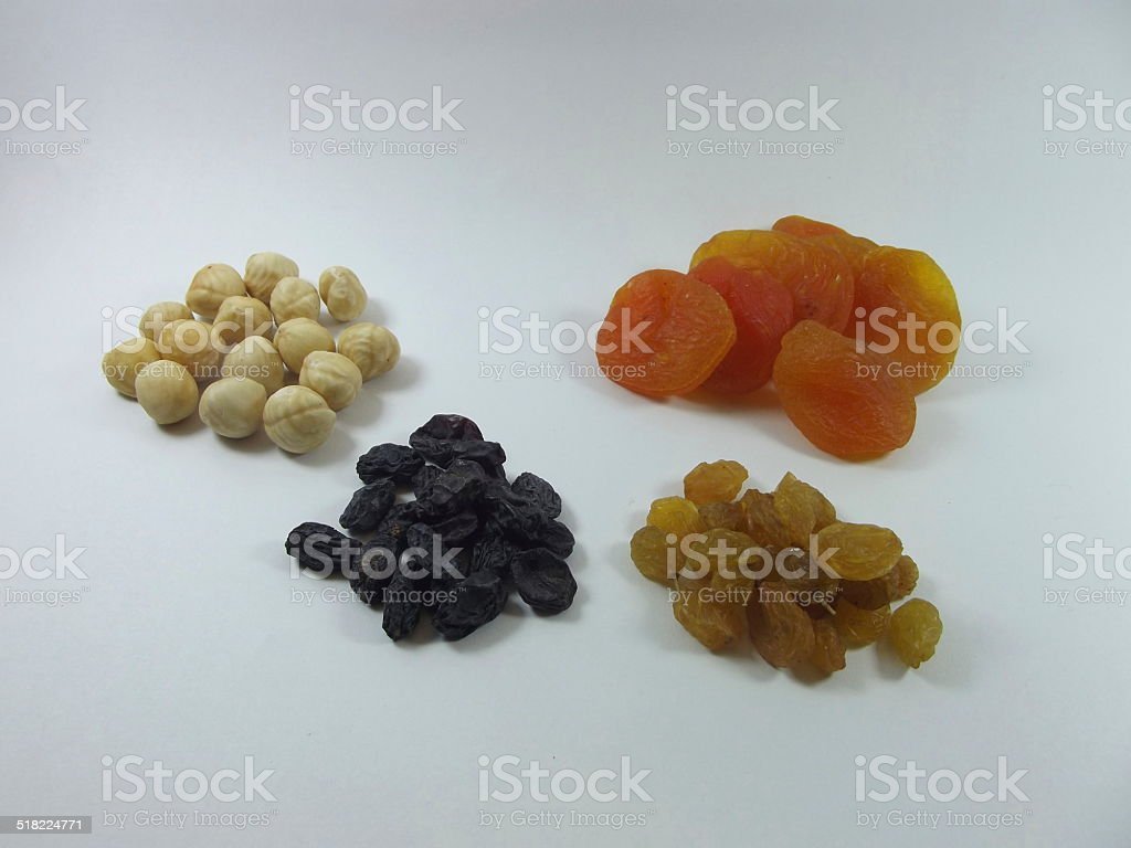 dried apricots, raisins and nuts Isolated on white stock photo