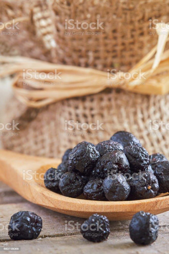 Dried aronia berries stock photo