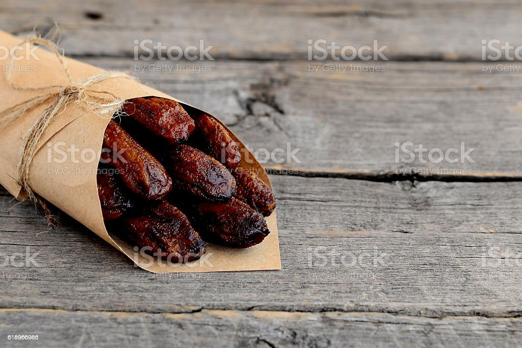Dried bananas fruits in wrapping paper stock photo