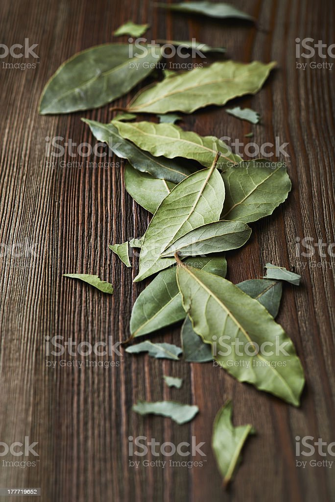 Dried bay leaves on wooden surface royalty-free stock photo