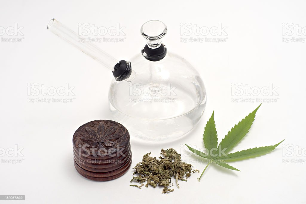 Dried Cannabis and  glass bong , isolated on white stock photo
