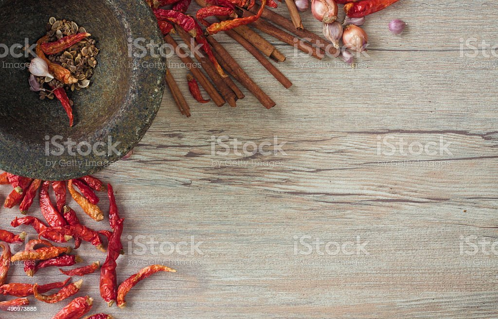 Dried Chili and spices in a stone mortar stock photo