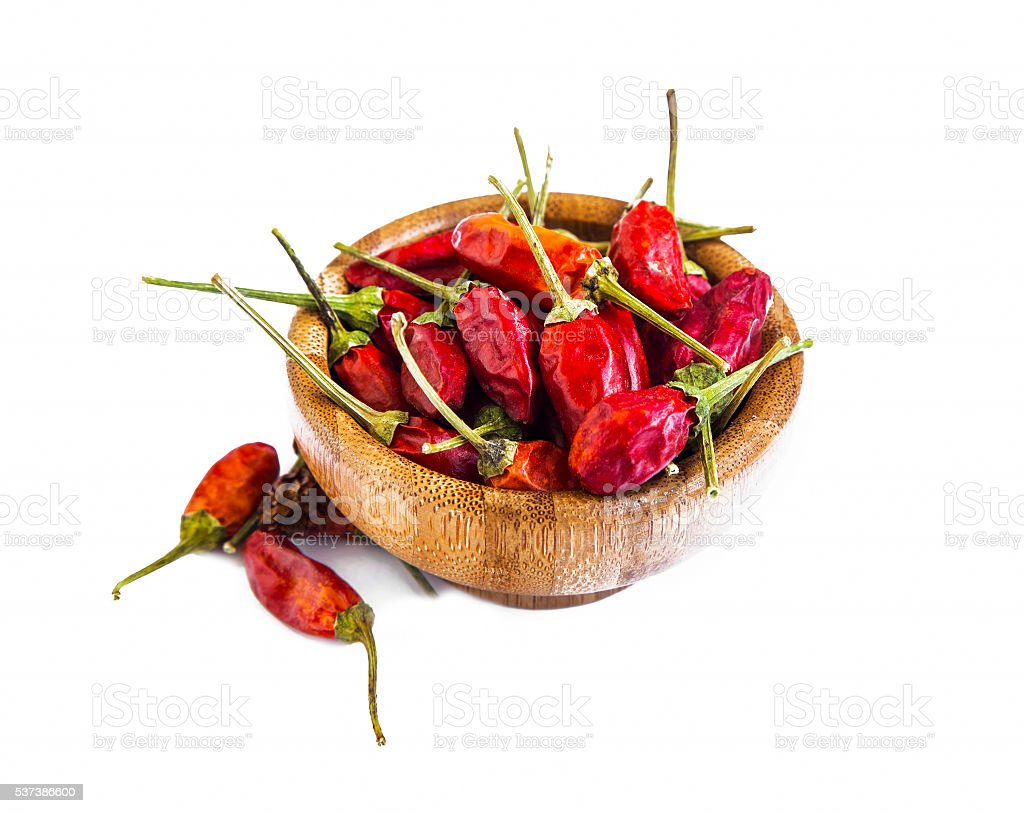 Dried chili flakes isolated on white stock photo
