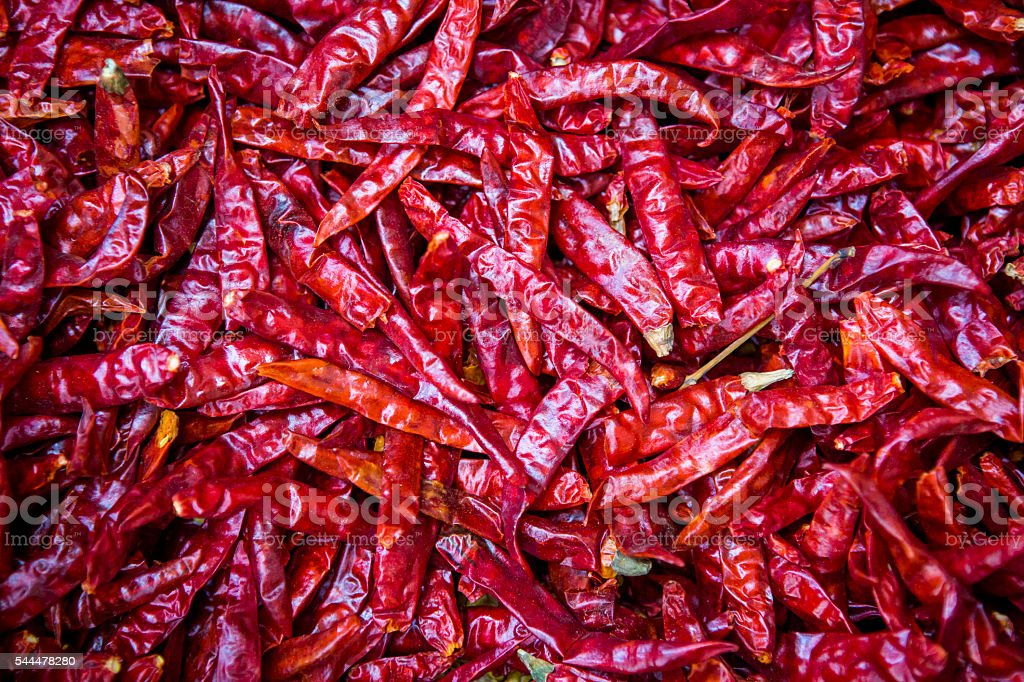 Dried chili peppers background. stock photo