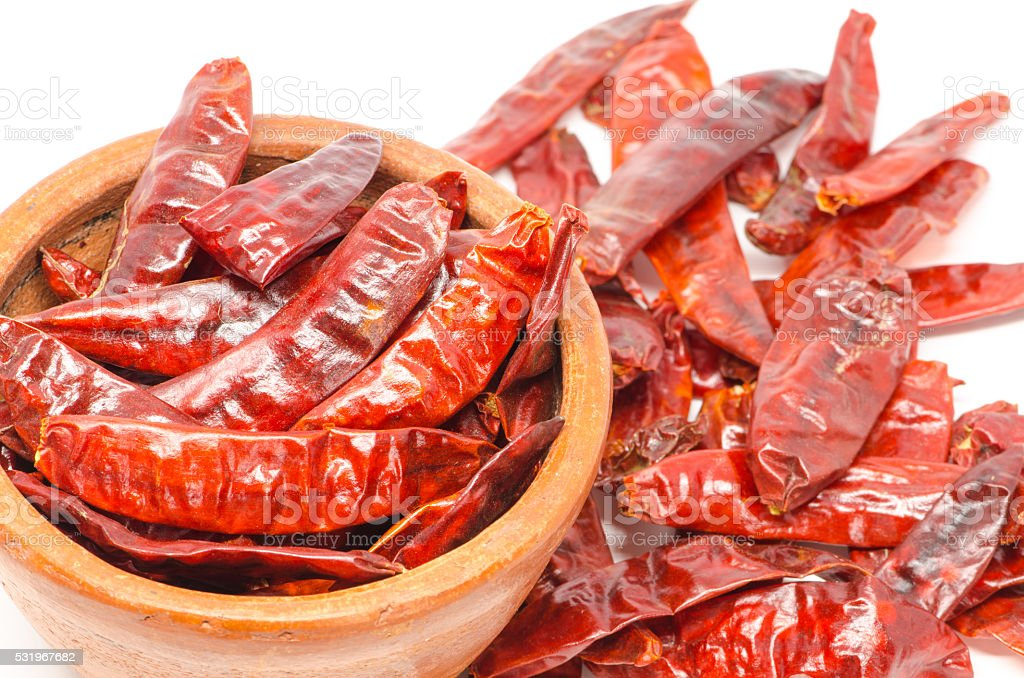 dried chili peppers on white background stock photo