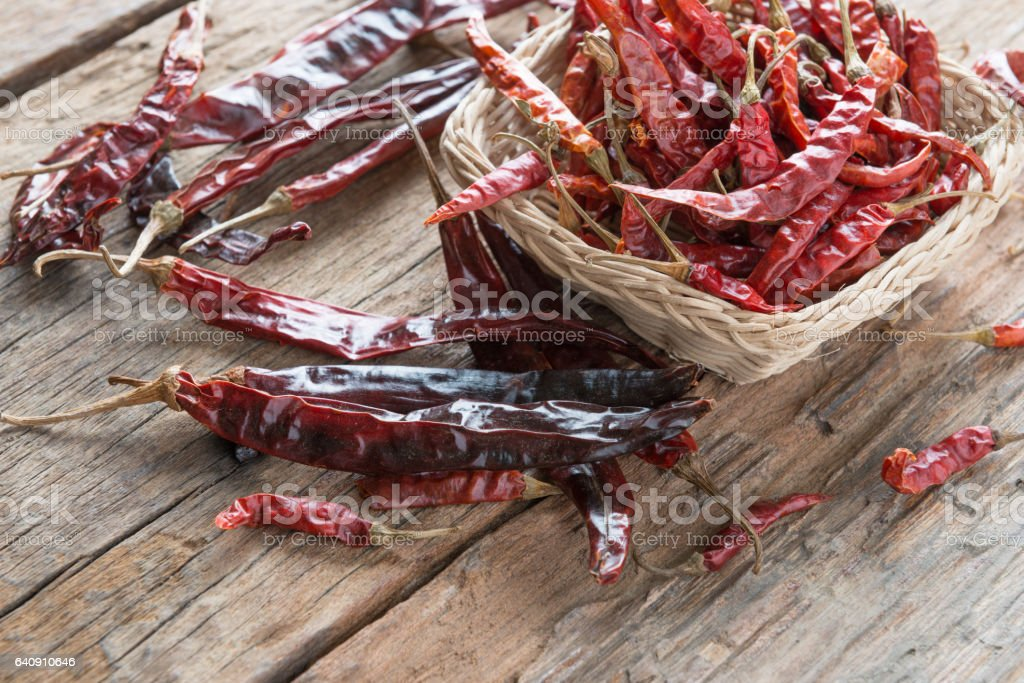 Dried chili peppers on wooden background stock photo