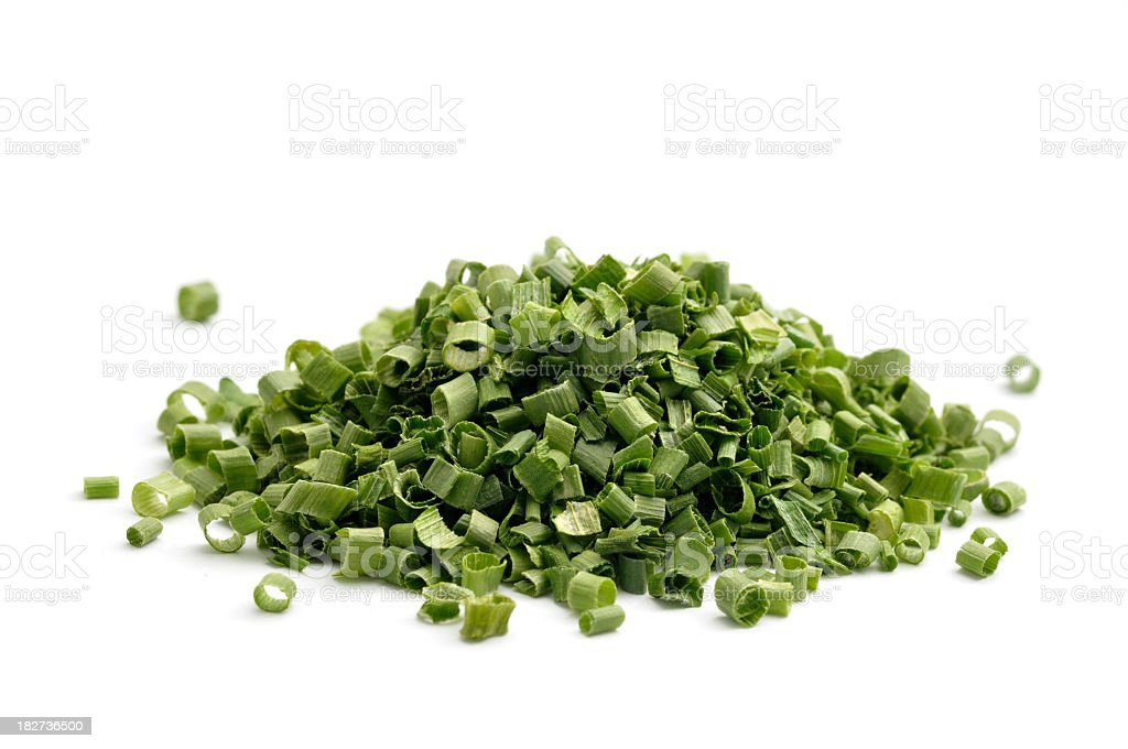 Dried chives in a pile against white background stock photo