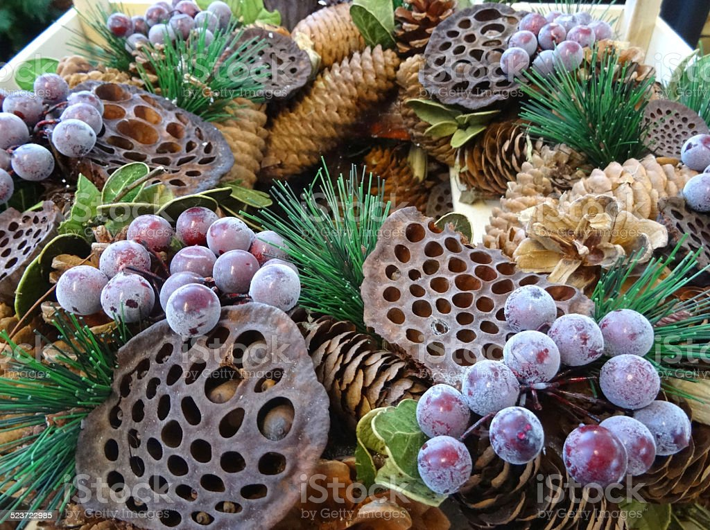 Dried Christmas wreath, pine-cones, lotus pods, spruce needles, berries / grapes stock photo