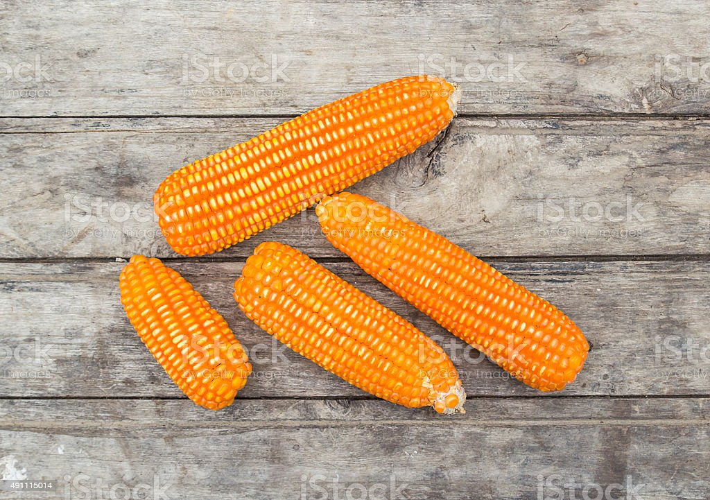 Dried corn on old wooden background stock photo