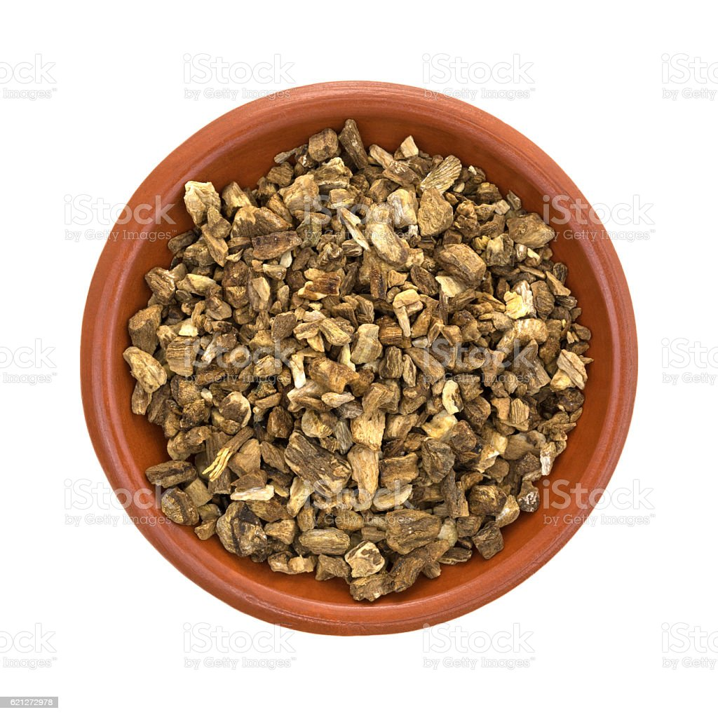 Dried cut and sifted burdock root in a small bowl stock photo