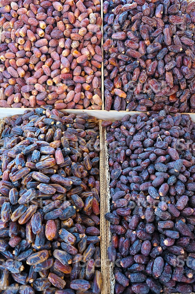 Dried date palm fruits or kurma at a market. stock photo