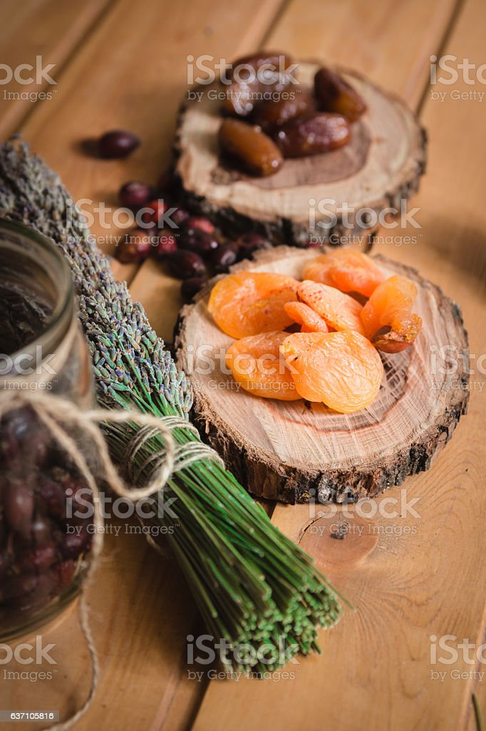 dried dates and apricots on wooden plates stock photo