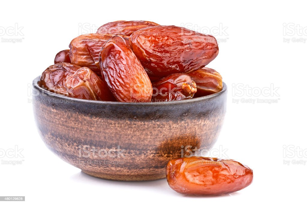 Dried Dates Fruit in brown cup isolated on white stock photo