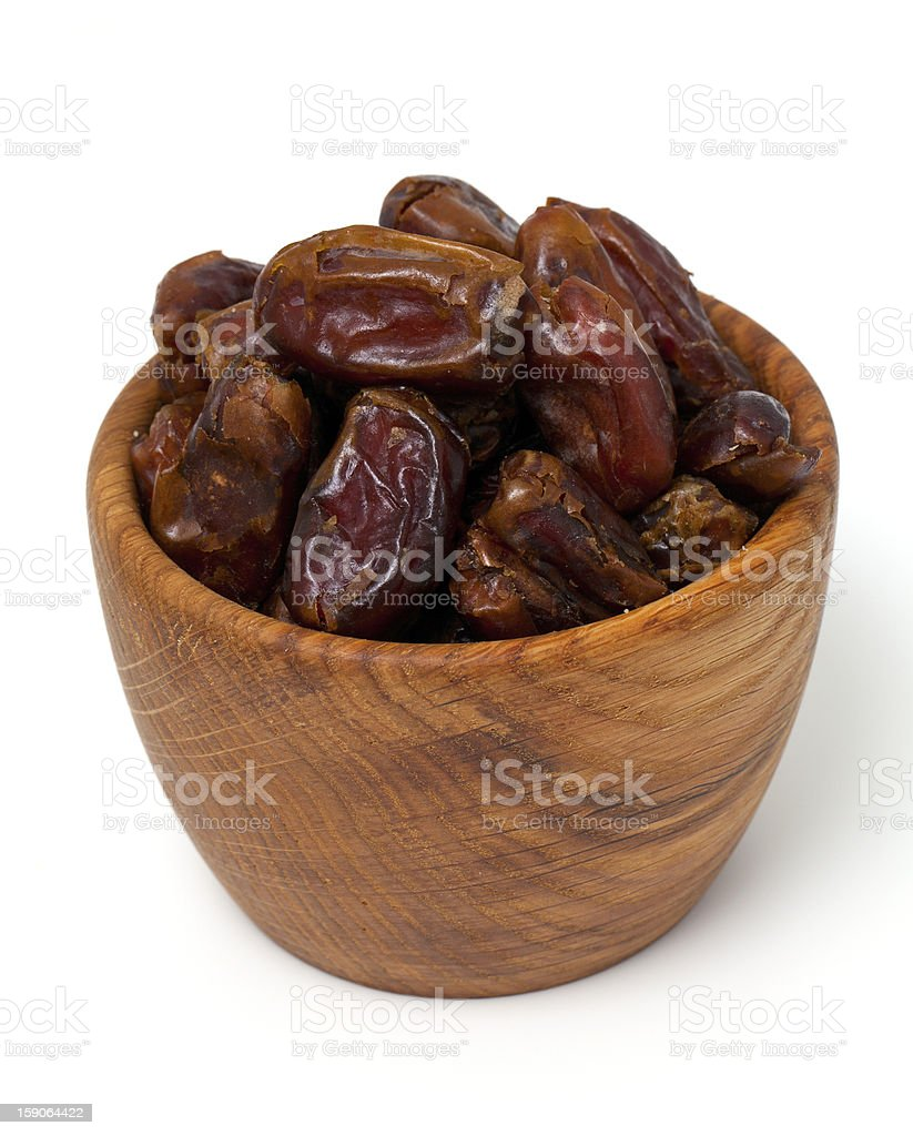 dried dates in a bowl over white royalty-free stock photo