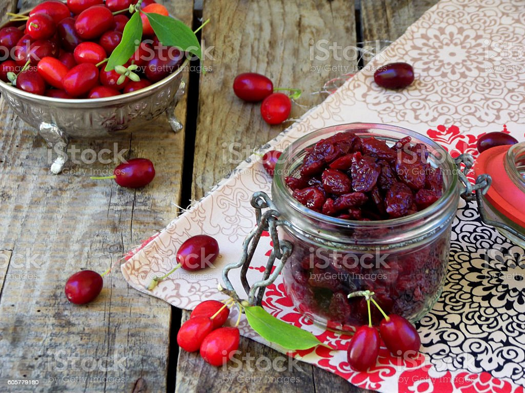 dried dogwood (cornelian cherry berry) in jar stock photo