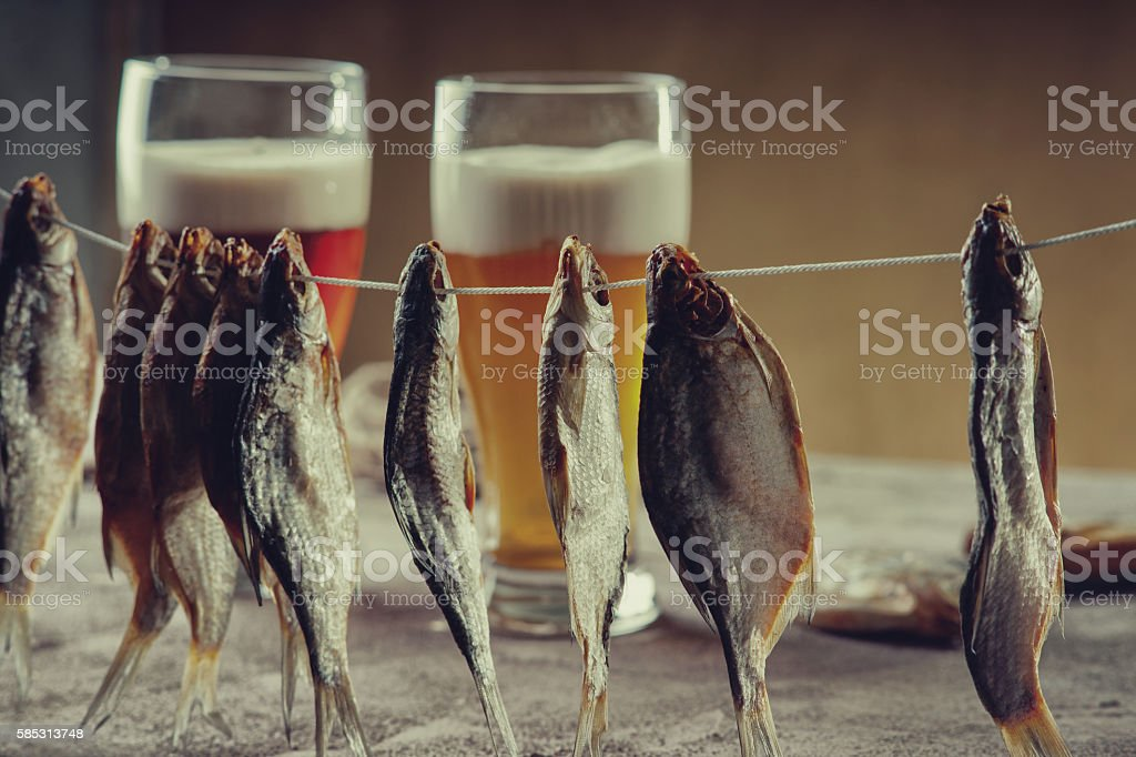 Dried fish and beer glasses stock photo