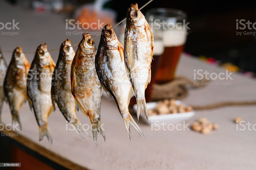 Dried fish and beer stock photo
