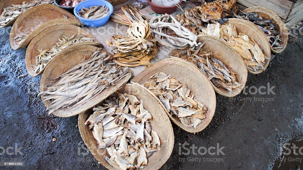 Dried fish in wooden baskets on asian market stock photo