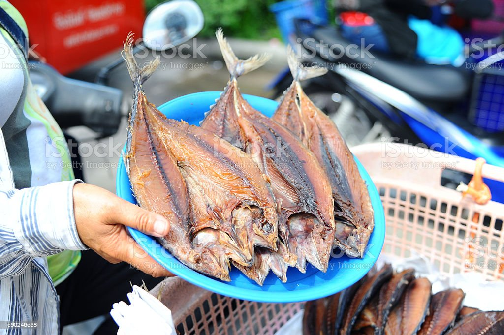 dried fish placed in a plate stock photo