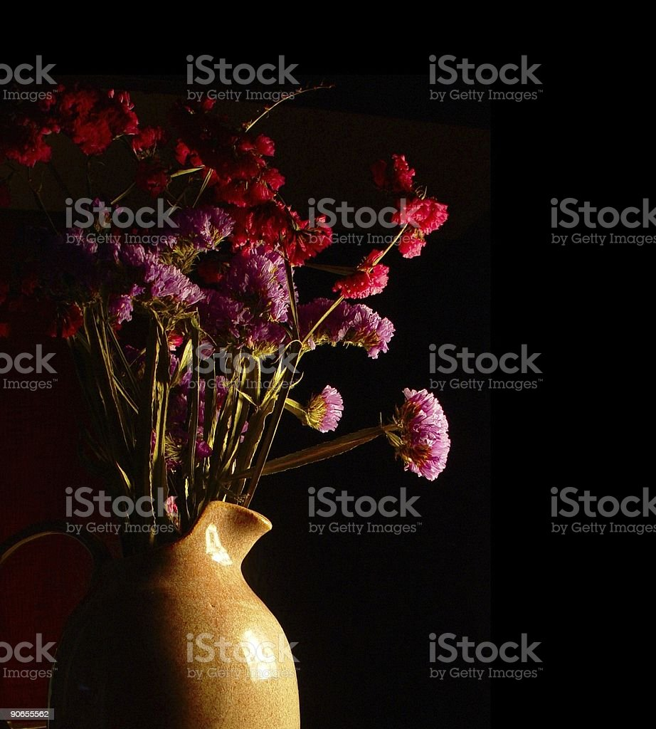 dried flowers and pitcher stock photo