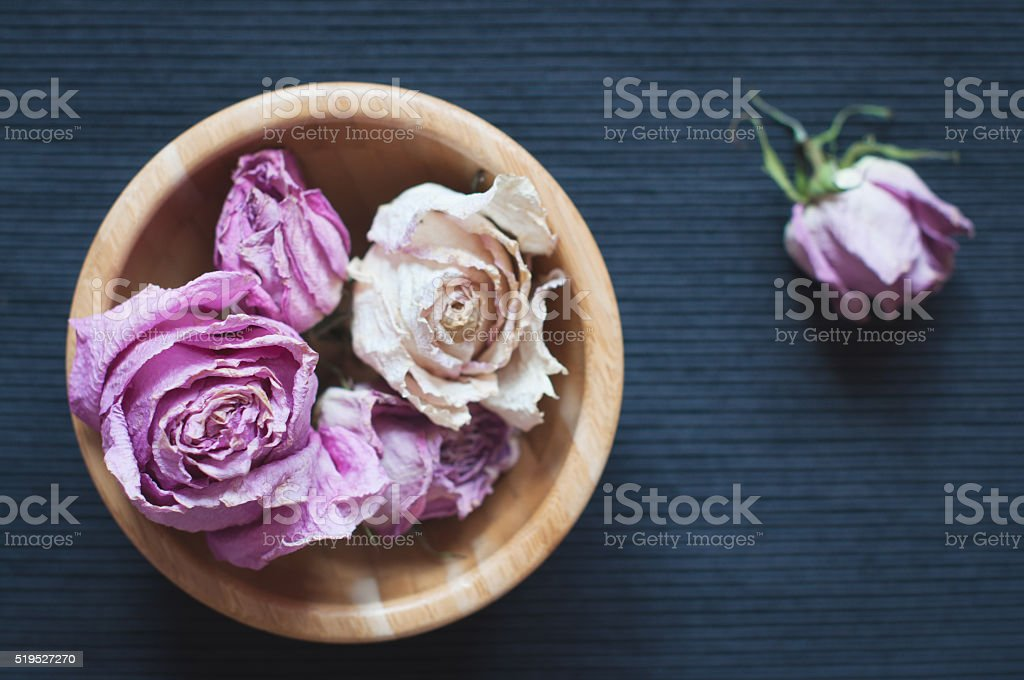 Dried flowers in wooden bowl, selective focus stock photo