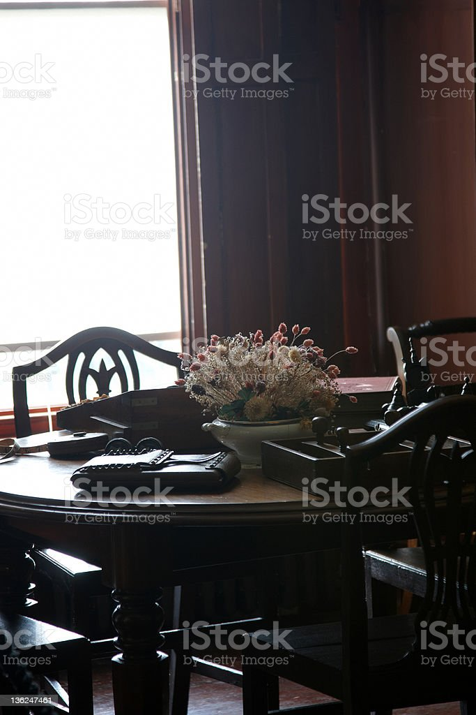 Dried flowers on sunlit study table