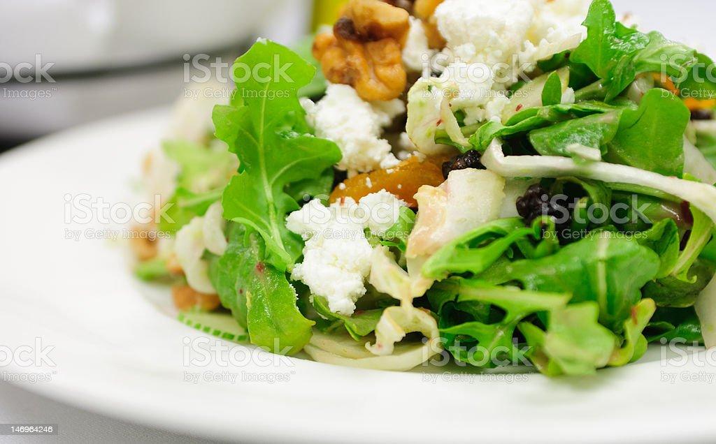 dried fruit and arugula salad stock photo