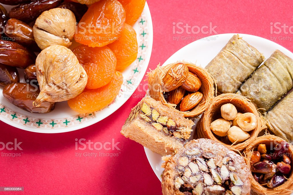 dried fruit and Eastern Turkish delights on a red background. stock photo