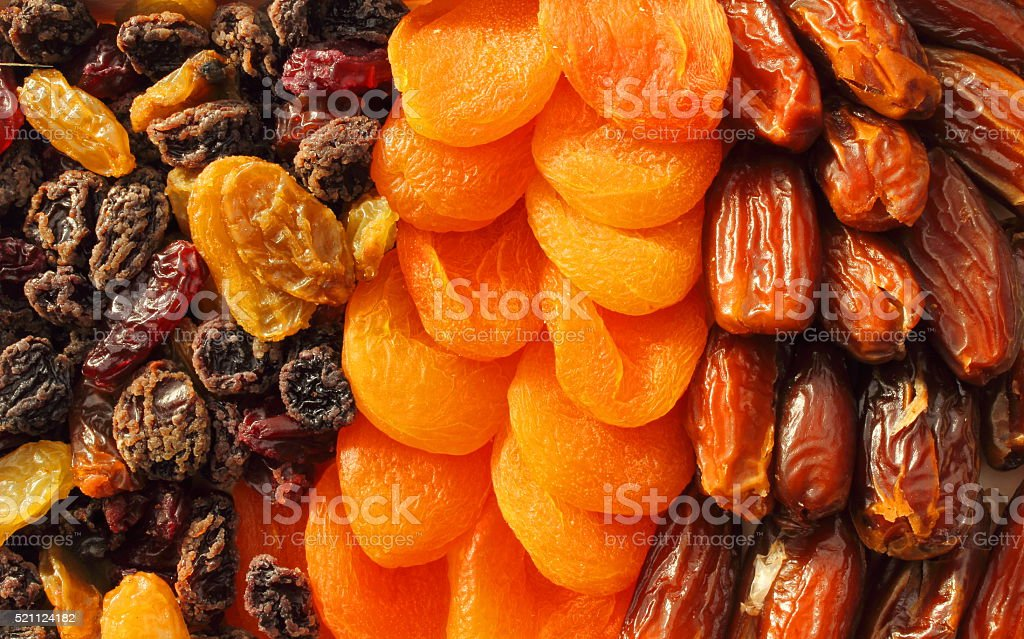 Dried fruit assortment of dates, raisins and apricots stock photo