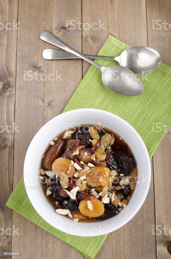 dried fruit compote with almond sliver stock photo