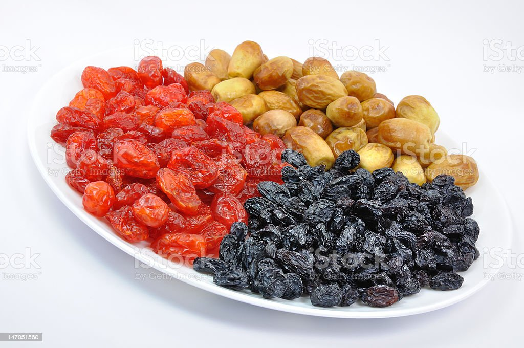 Dried Fruit on White Plate Isolated royalty-free stock photo
