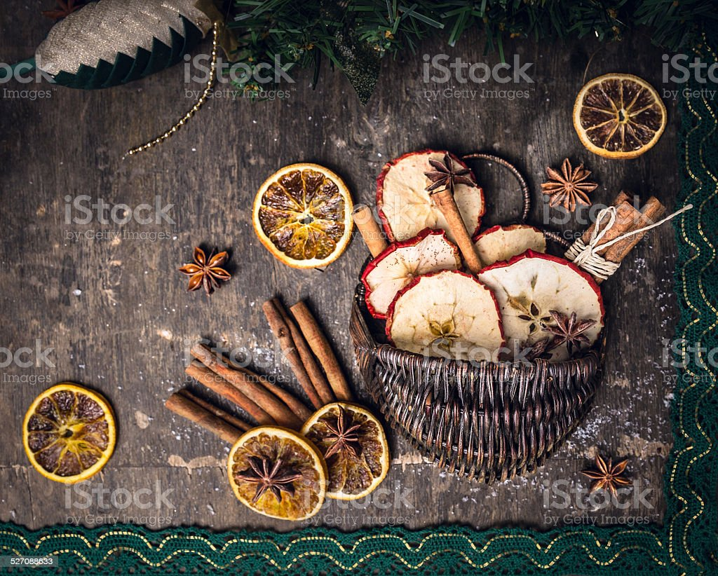 dried fruit with cinnamon sticks and anis star in basket stock photo