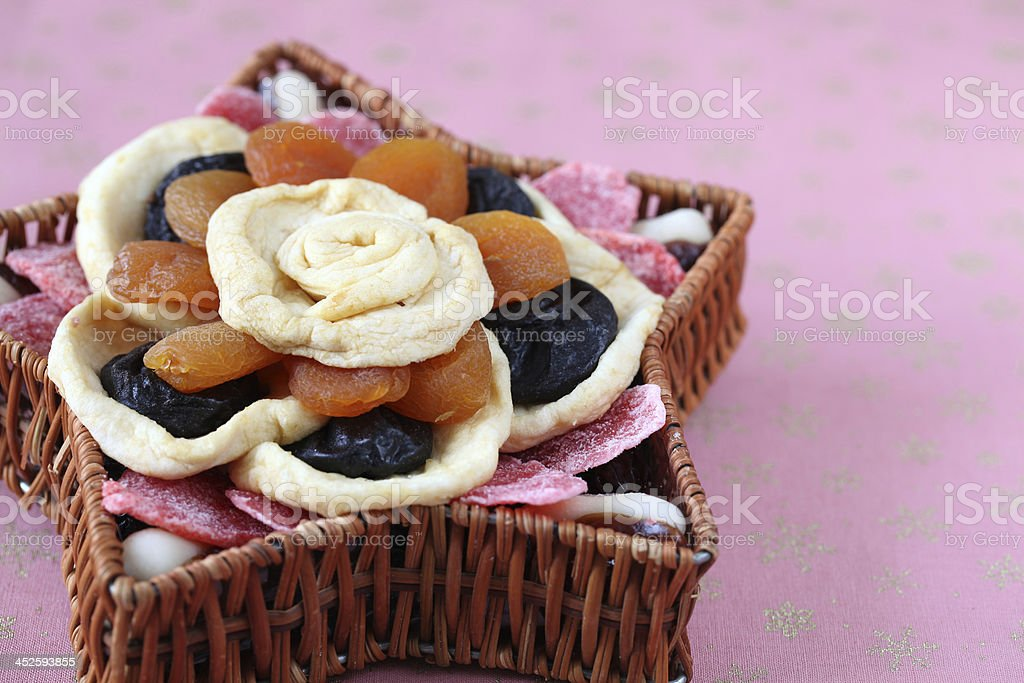 Dried fruits in a basket stock photo