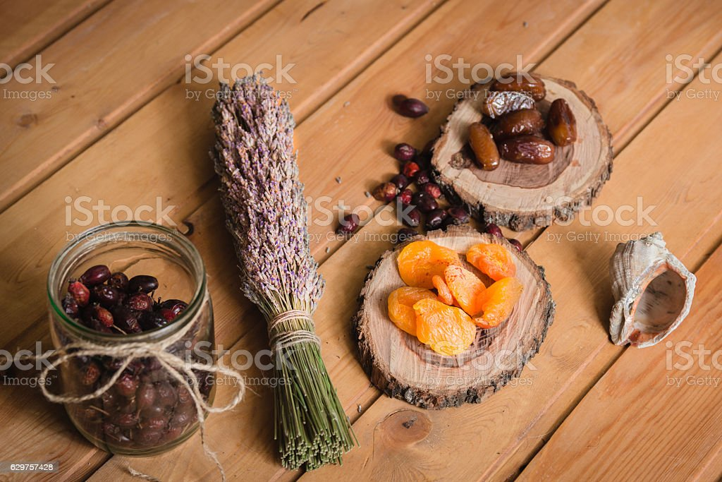 dried fruits on wooden plates and berries stock photo