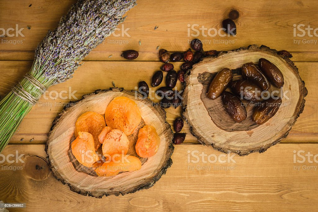 dried fruits on wooden plates stock photo