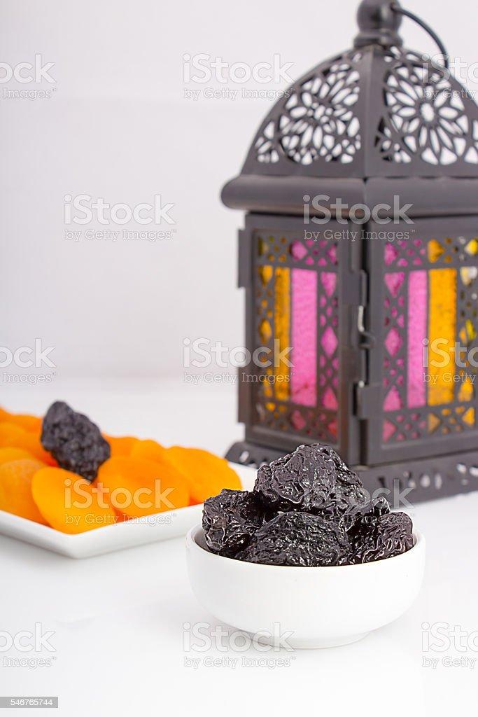 Dried fruits with Ramadan lantern for iftar stock photo