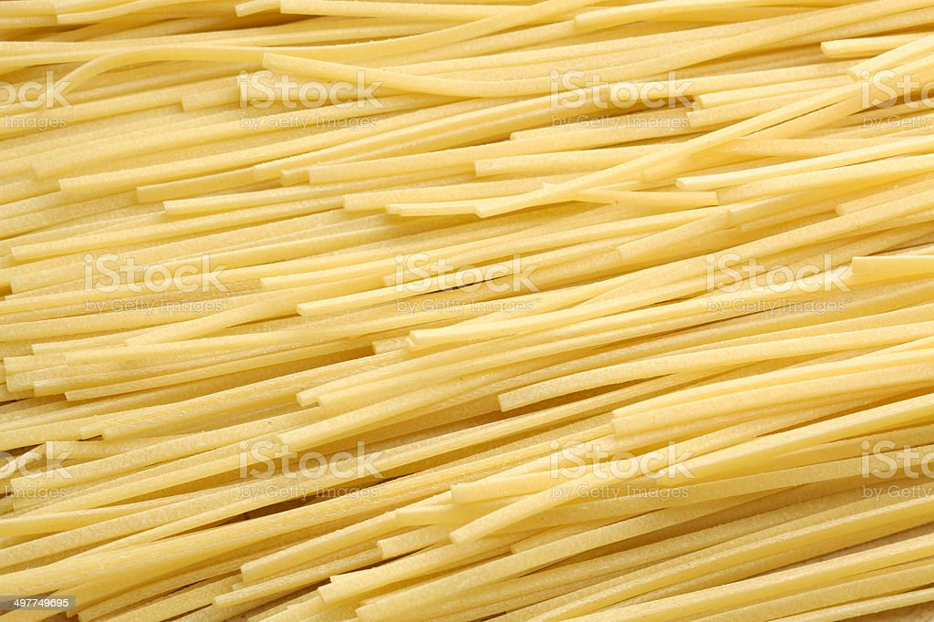 Dried full frame image of dry uncooked spaghetti royalty-free stock photo