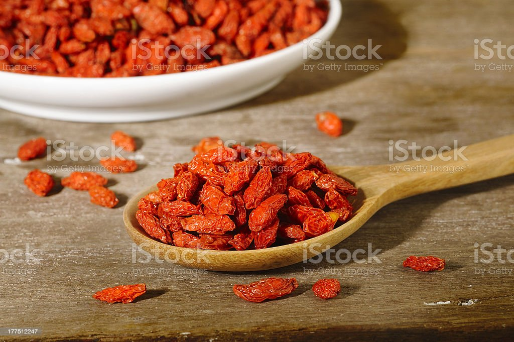dried goji berries in wooden spoon royalty-free stock photo